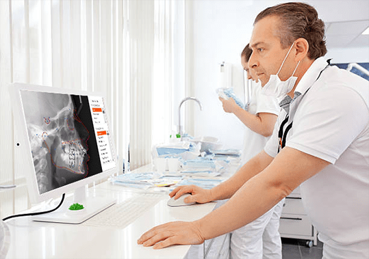 Orthodontist looking at CephX cephalometric analysis report